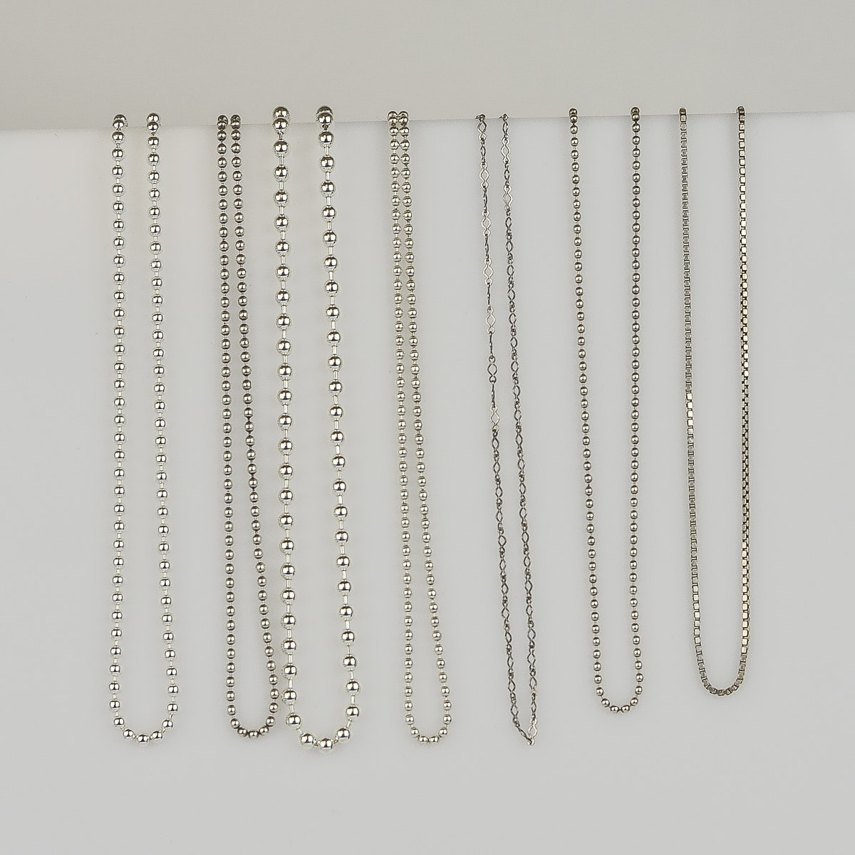 Collection of Seven Sterling Silver Chains