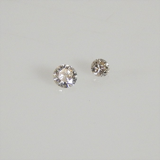Two Loose Round Brilliant Cut Diamonds - 0.18 CT and 0.09 CT