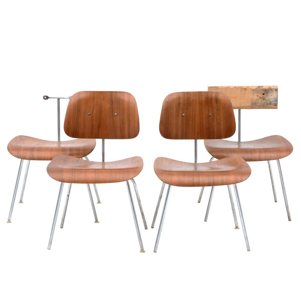 Four Herman Miller DCM Walnut Side Chairs