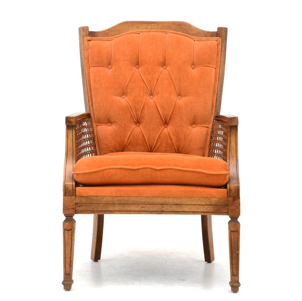 Orange Button-Tufted Wicker Armchair