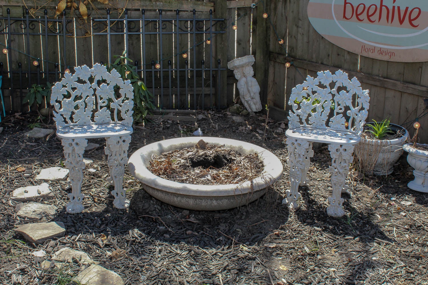 Marble Fountain and White Iron Chairs