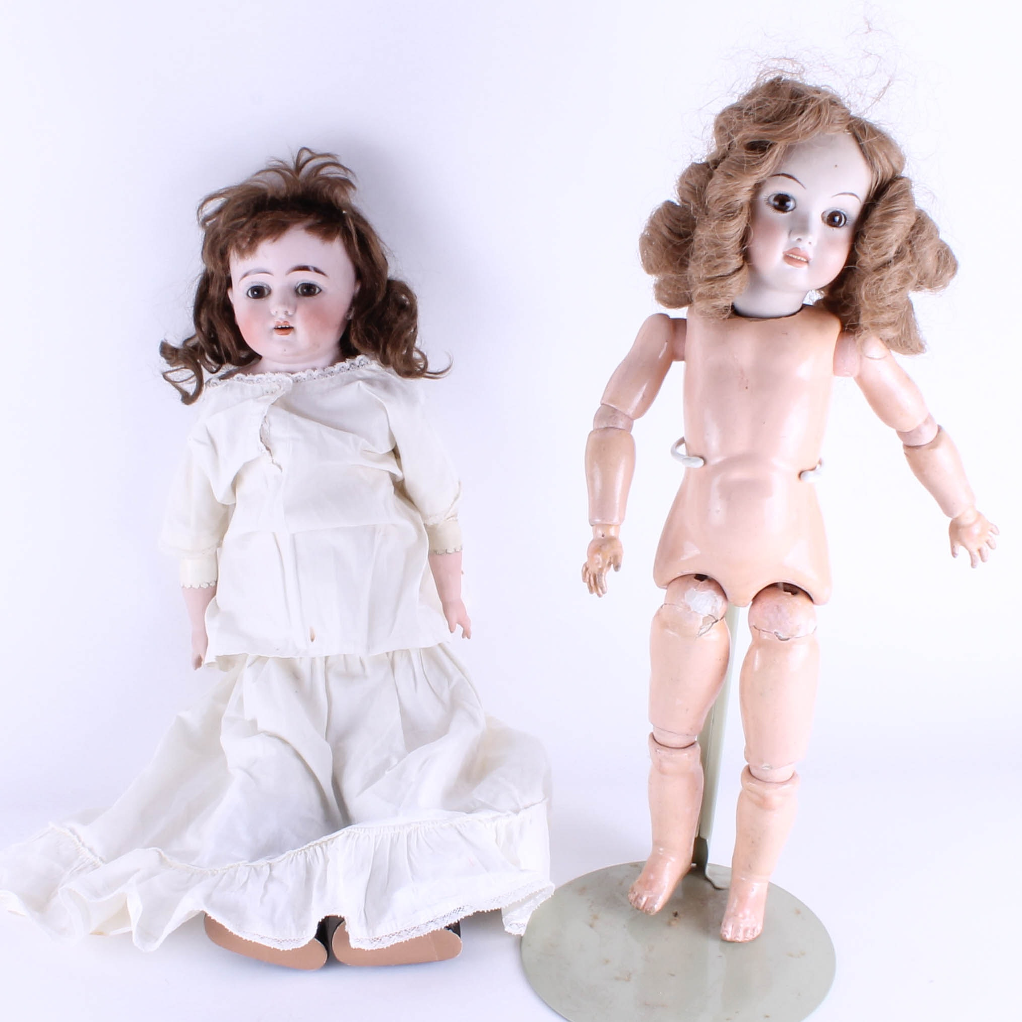 Pair of Antique Bisque and Composition Dolls