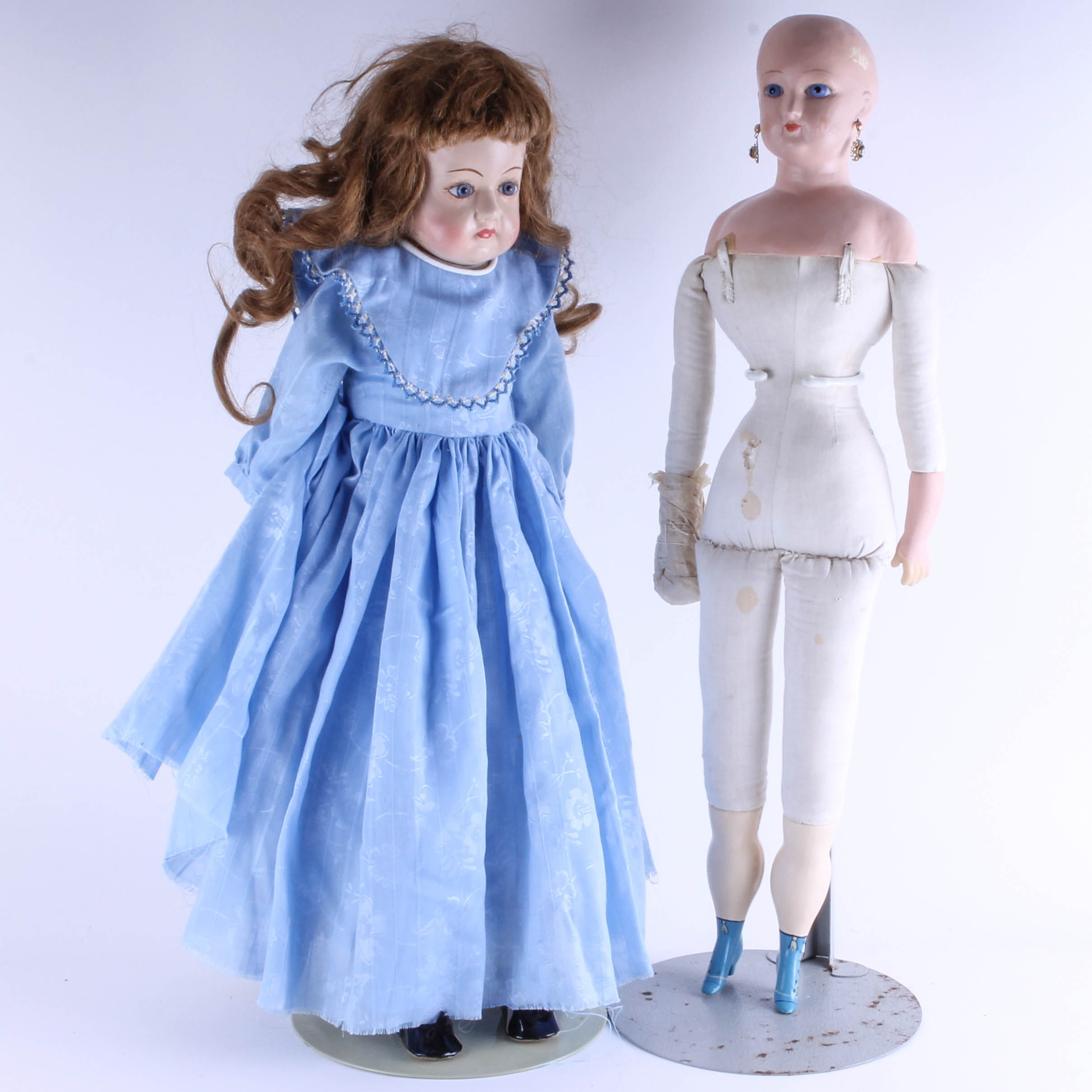 Two Vintage Composition and Kid Leather Dolls