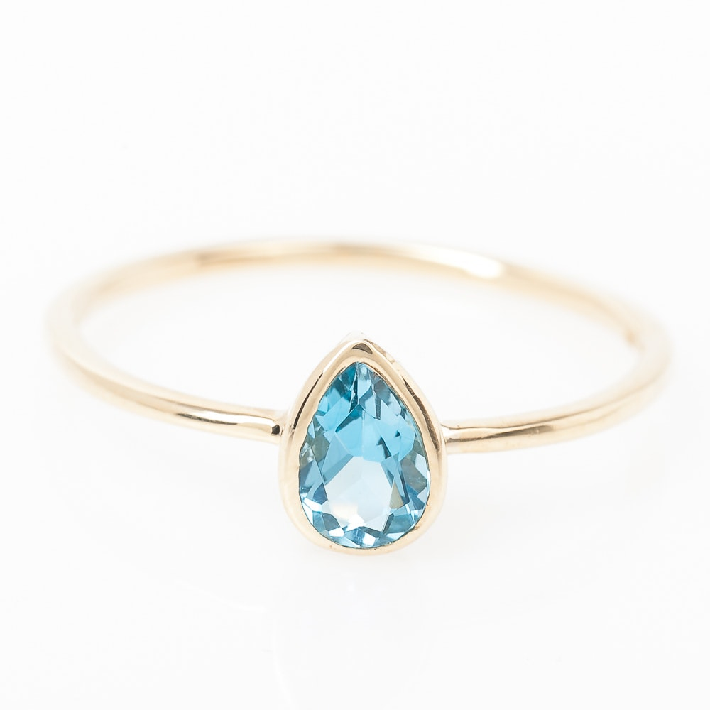 14K Yellow Gold and Bezel Set Blue Topaz Solitaire Ring