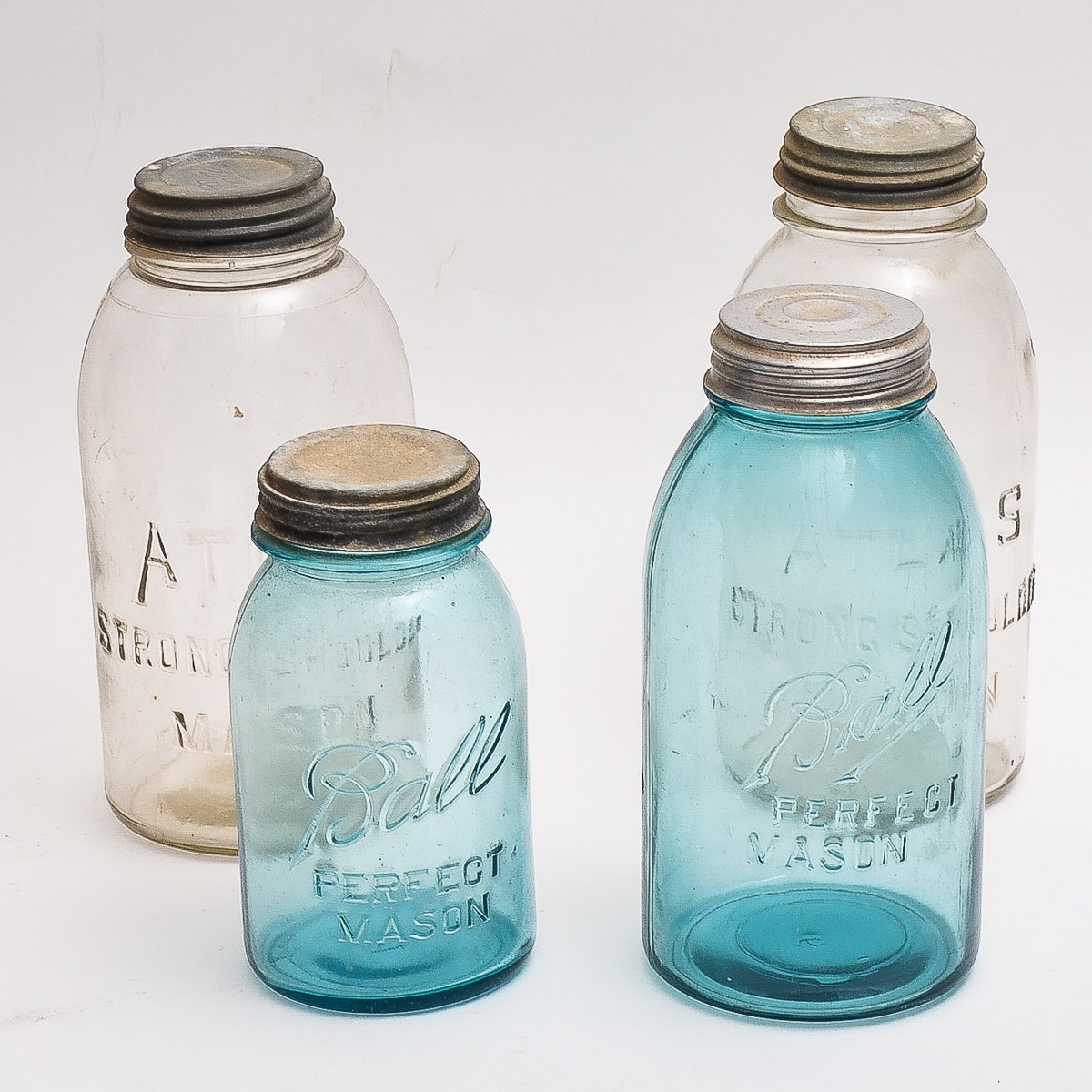 Four Vintage Glass Mason Jars
