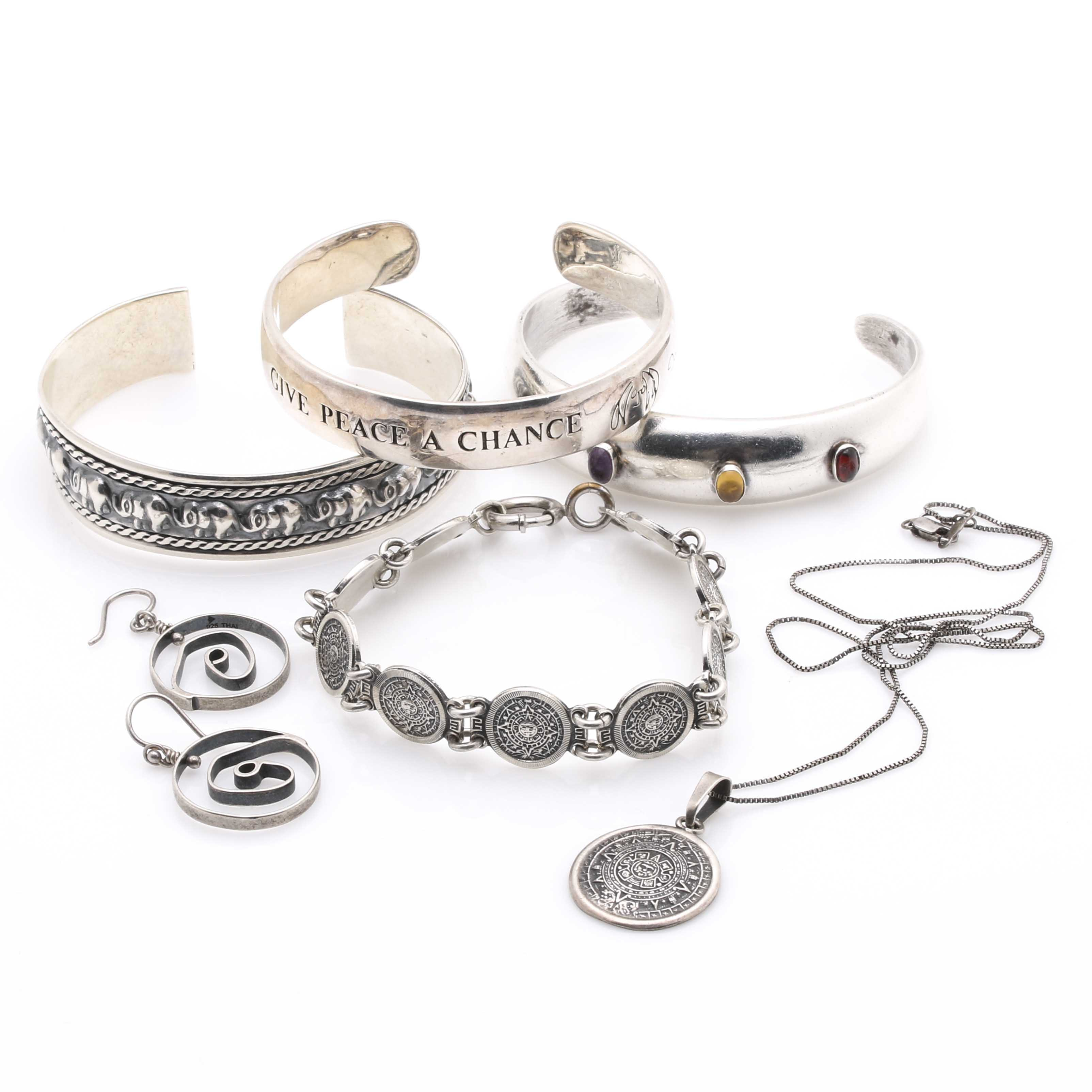 Sterling Silver Cuff Bracelets With Assorted Items