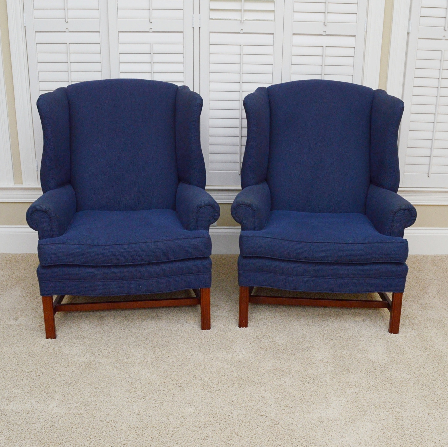 pair of wing back chairs by conover chair company