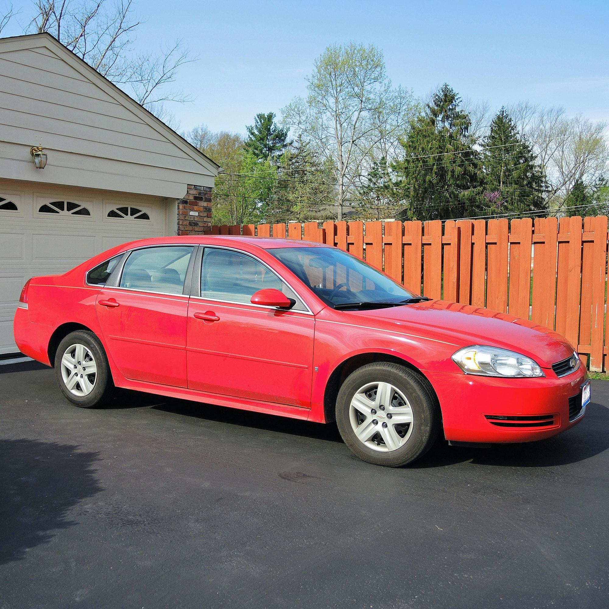 2010 Red Chevy Impala Sedan