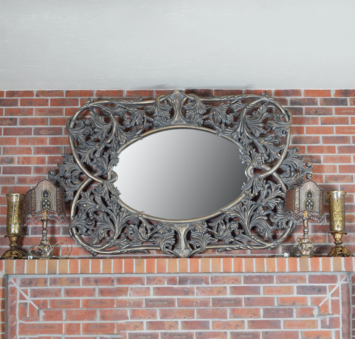 Ornate Wall Mirror and Grouping of Small Lamps