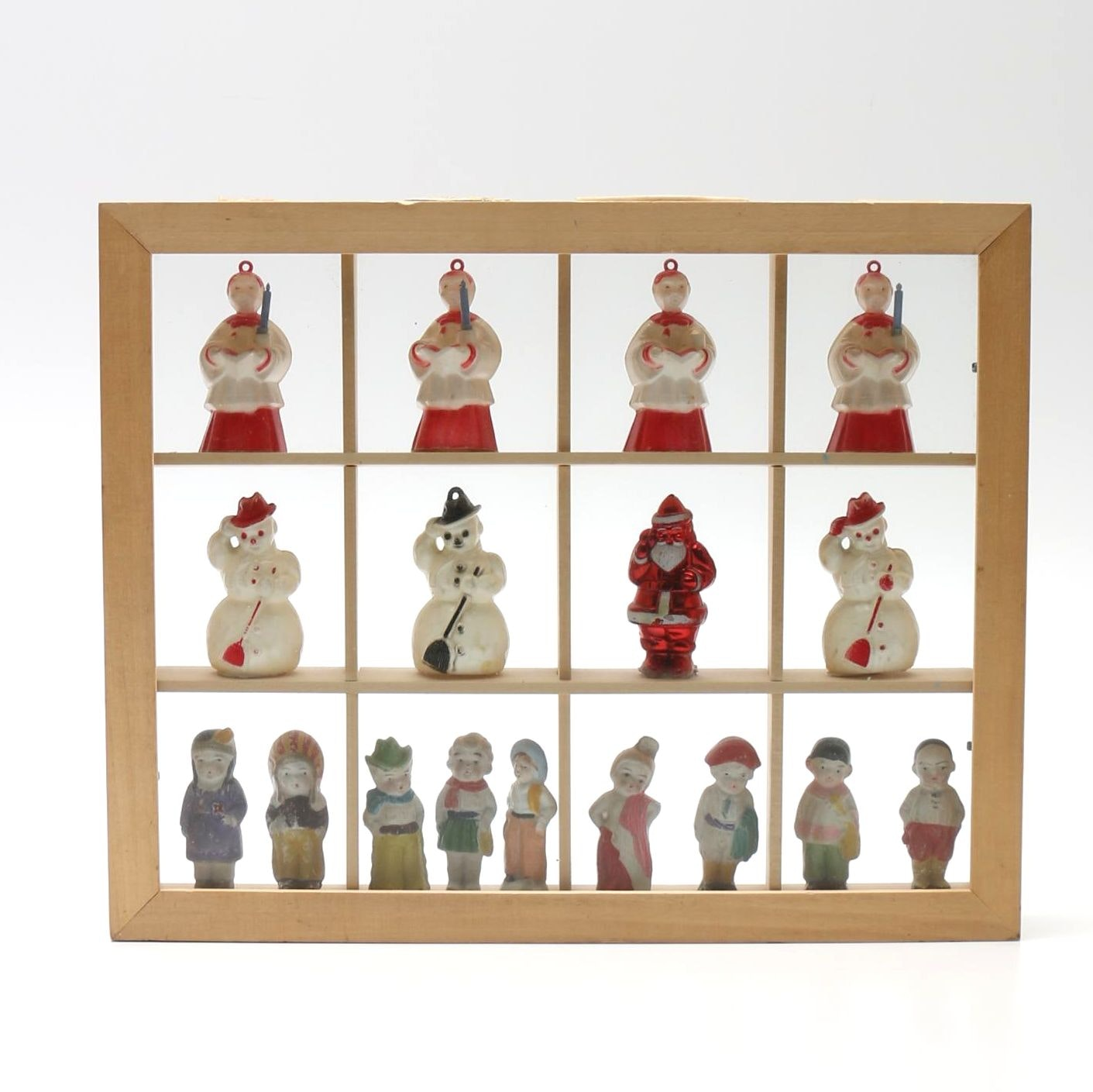 Shadow Box Filled With Figurines and Ornaments