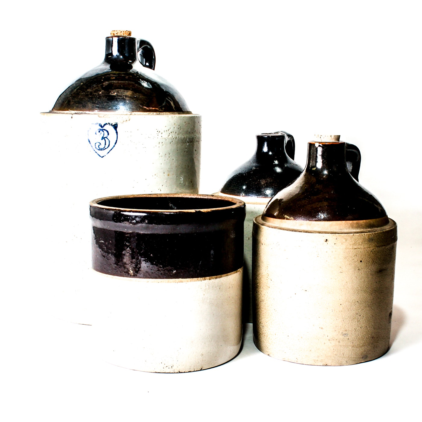 Collection of Vintage Stoneware Whiskey Jugs with Small Stoneware Crock
