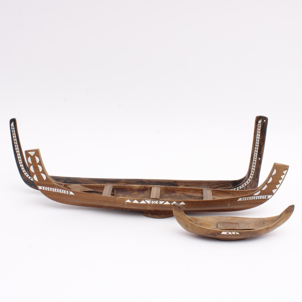 Carved Wooden Canoe Sculptures