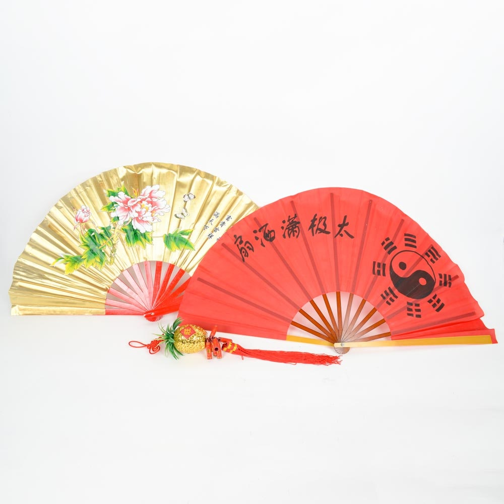 Collection of Chinese Fans and Golden Pineapple Chinese New Year Tassel