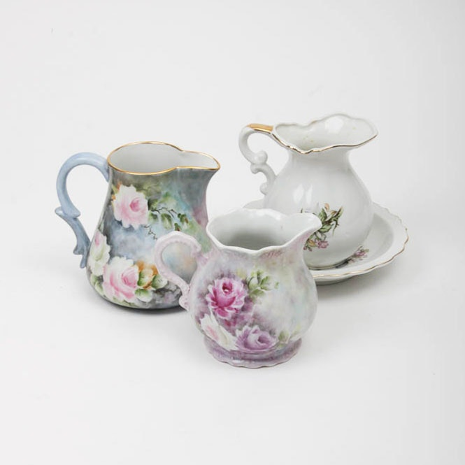 Three Floral Pitchers