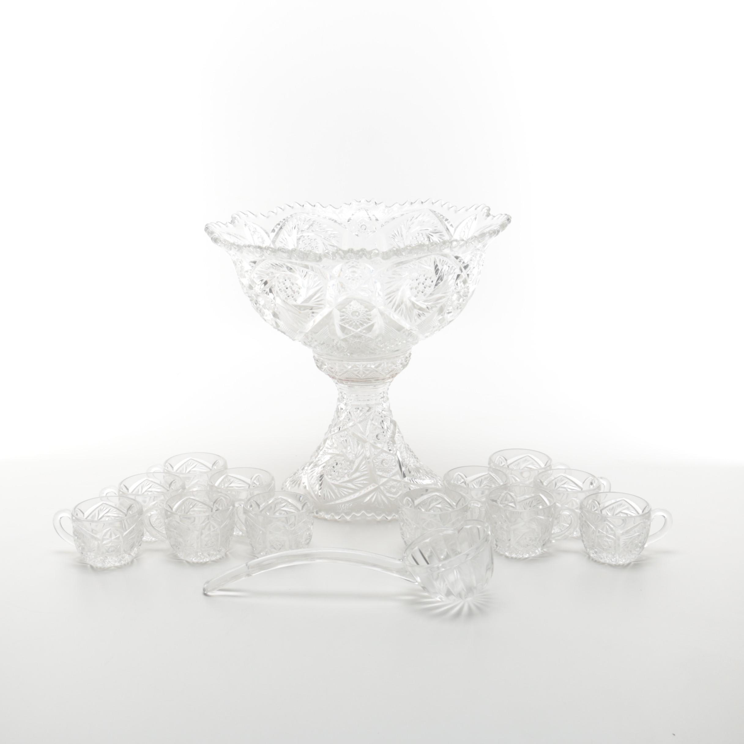Footed Punch Bowl With Ladle And Twelve Cups