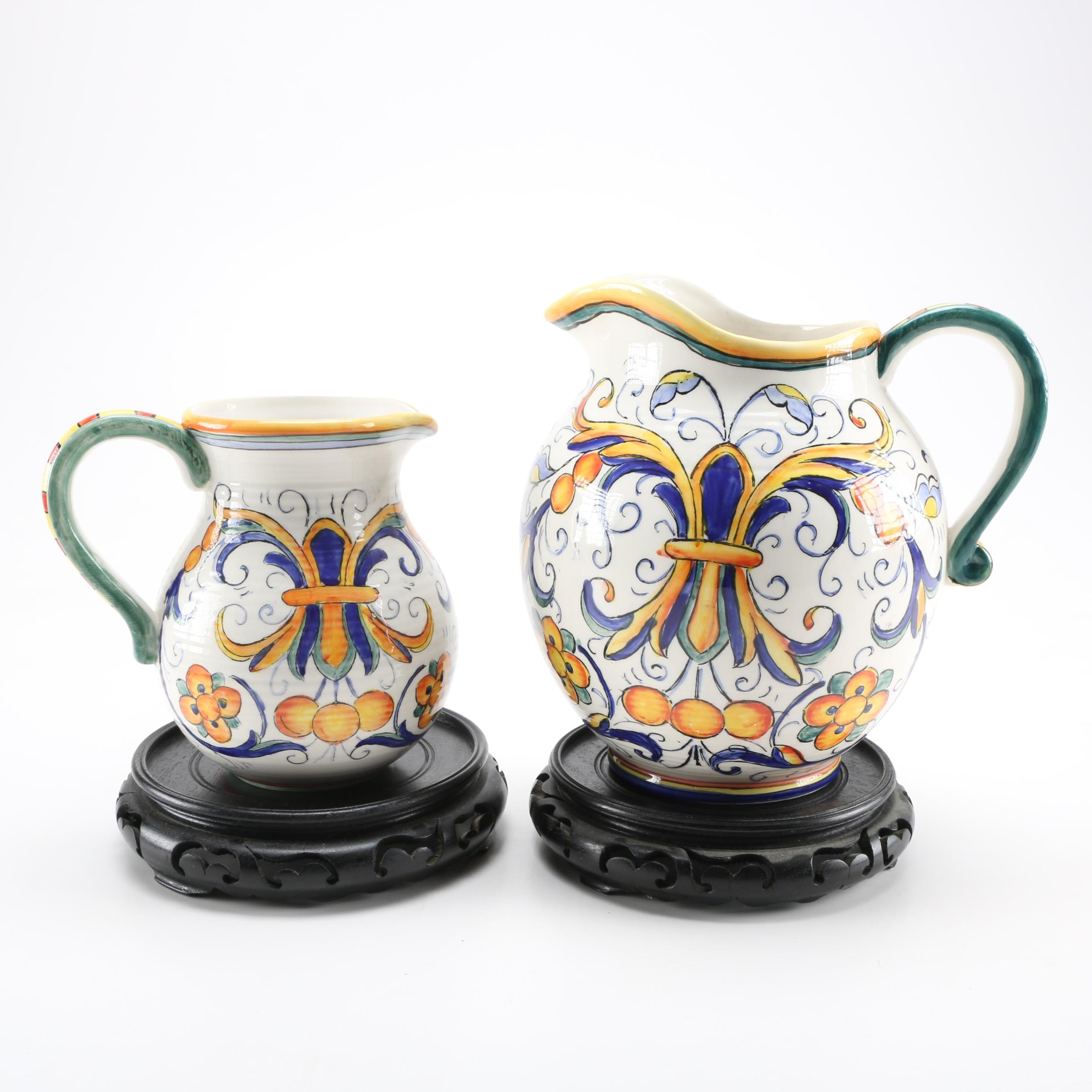 Italian-Style Ceramic Pitchers Including Wooden Stands