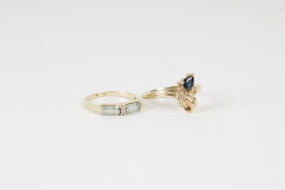 Two 14K Yellow Gold Aquamarine and Sapphire Rings with Diamonds
