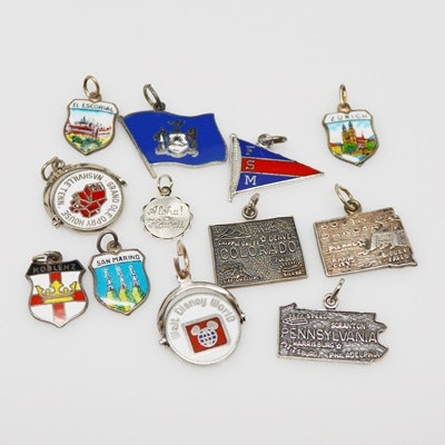 Twelve Sterling Silver and 800 Silver Travel Charms
