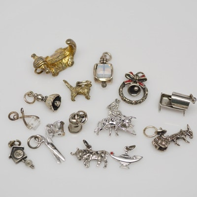 Fourteen Sterling Silver Charms