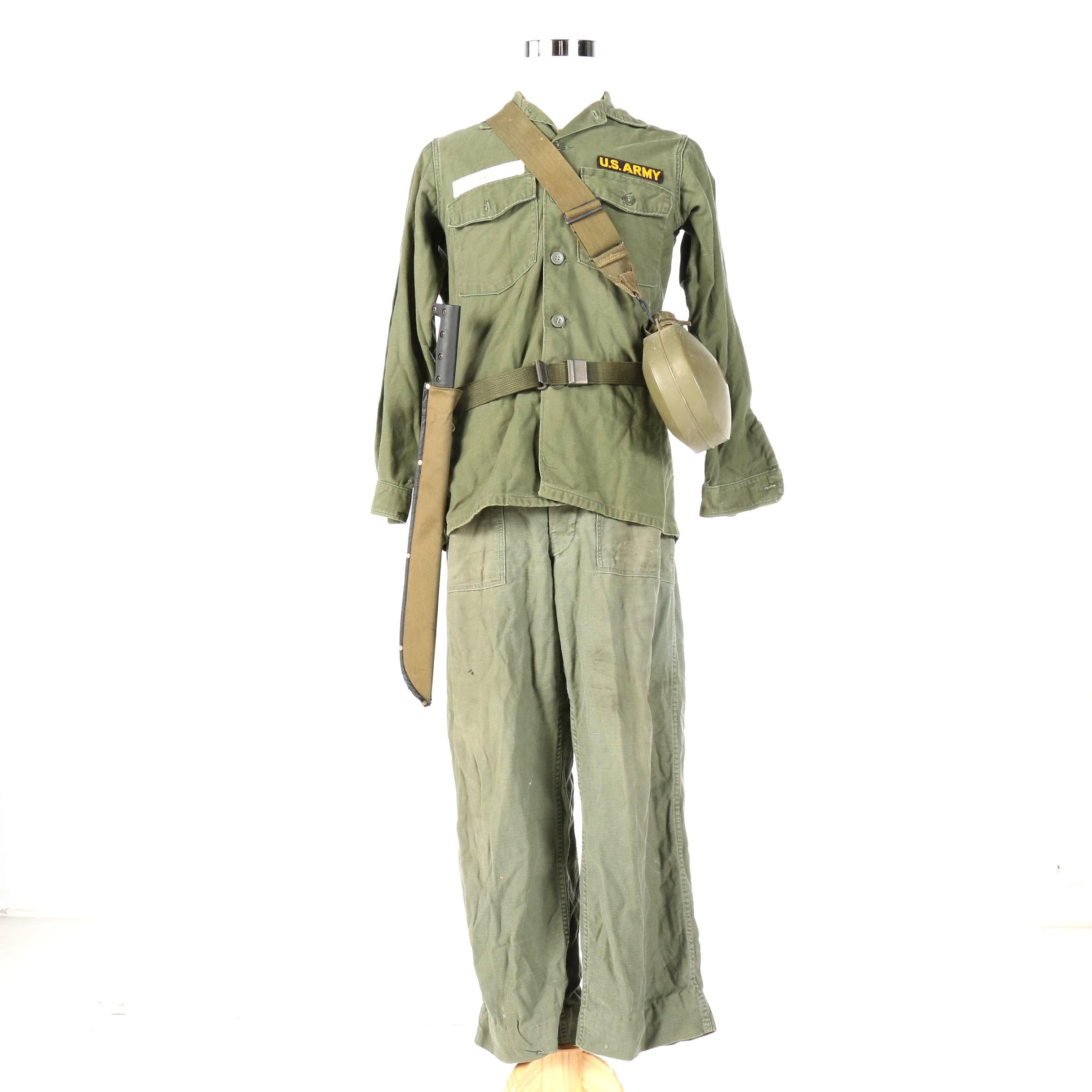 U.S. Military Uniform From the Vietnam War Era with Machete and Canteen