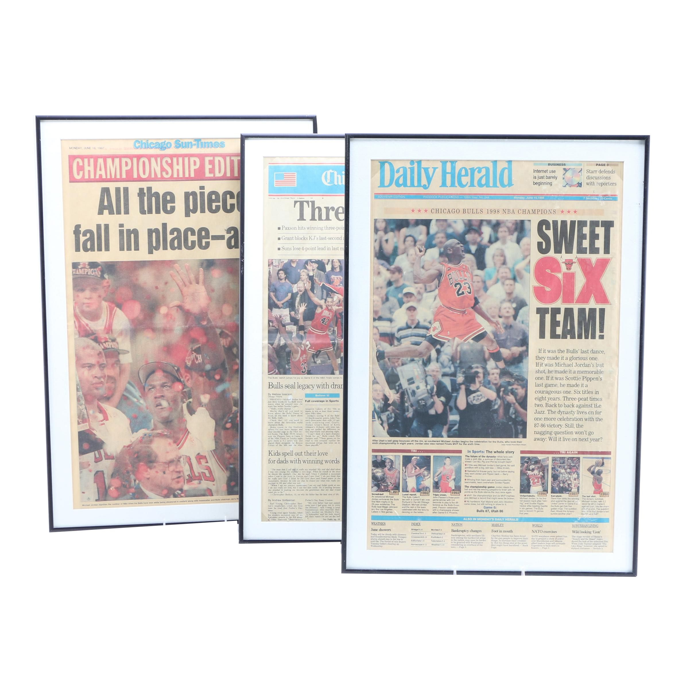 Three Framed Newspapers Featuring Stories on the Chicago Bulls