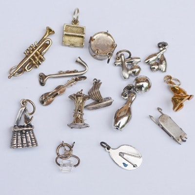 Fifteen Sterling Silver and Mixed Metal Charms