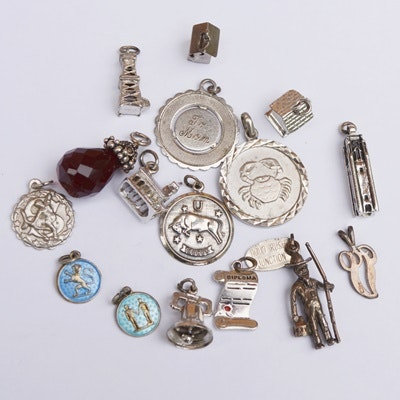 Sixteen Sterling Silver Charms