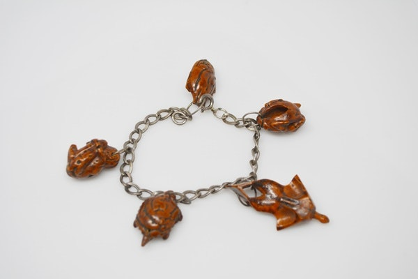 Sterling Silver Bracelet With Hand Carved Peach Pit Charms