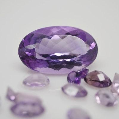 Thirteen Loose Natural Amethyst Gemstones Including a 29.50 CTS Amethyst