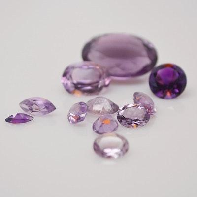 Twelve Loose 39.47 CTW Natural Amethyst Gemstones