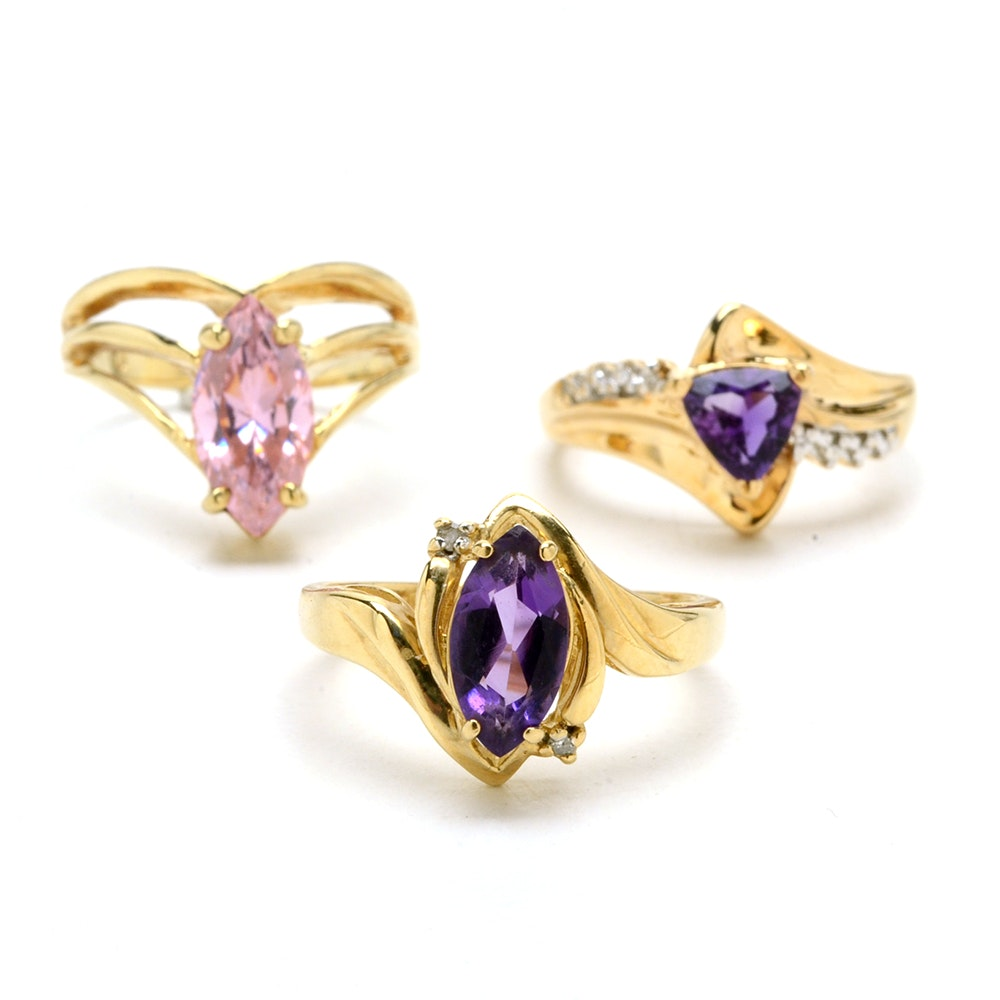 Three 10K Yellow Gold Rings Including Amethyst and Diamonds
