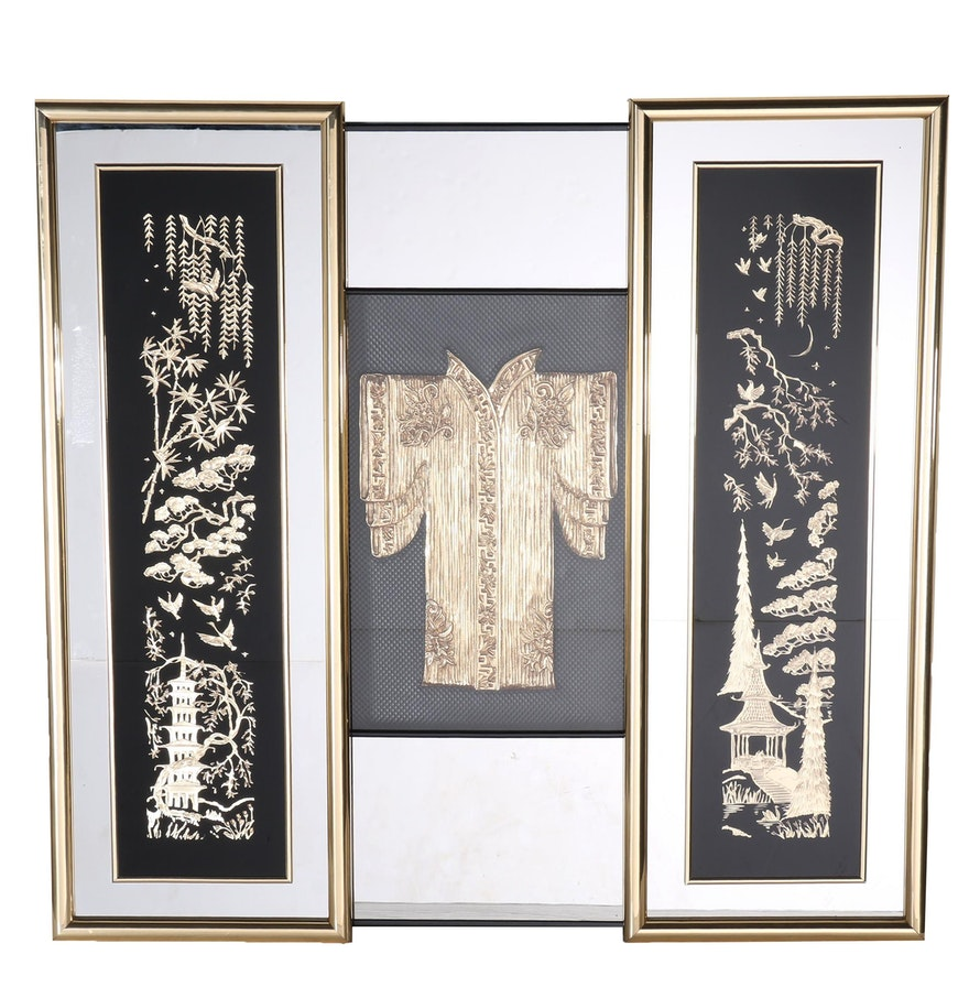 chinese inspired carved wooden scenes in mirrored frames