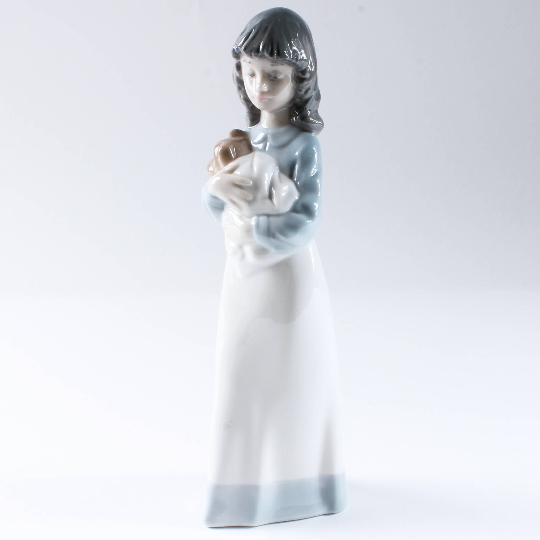Woman Holding Puppy Lladro Figurine