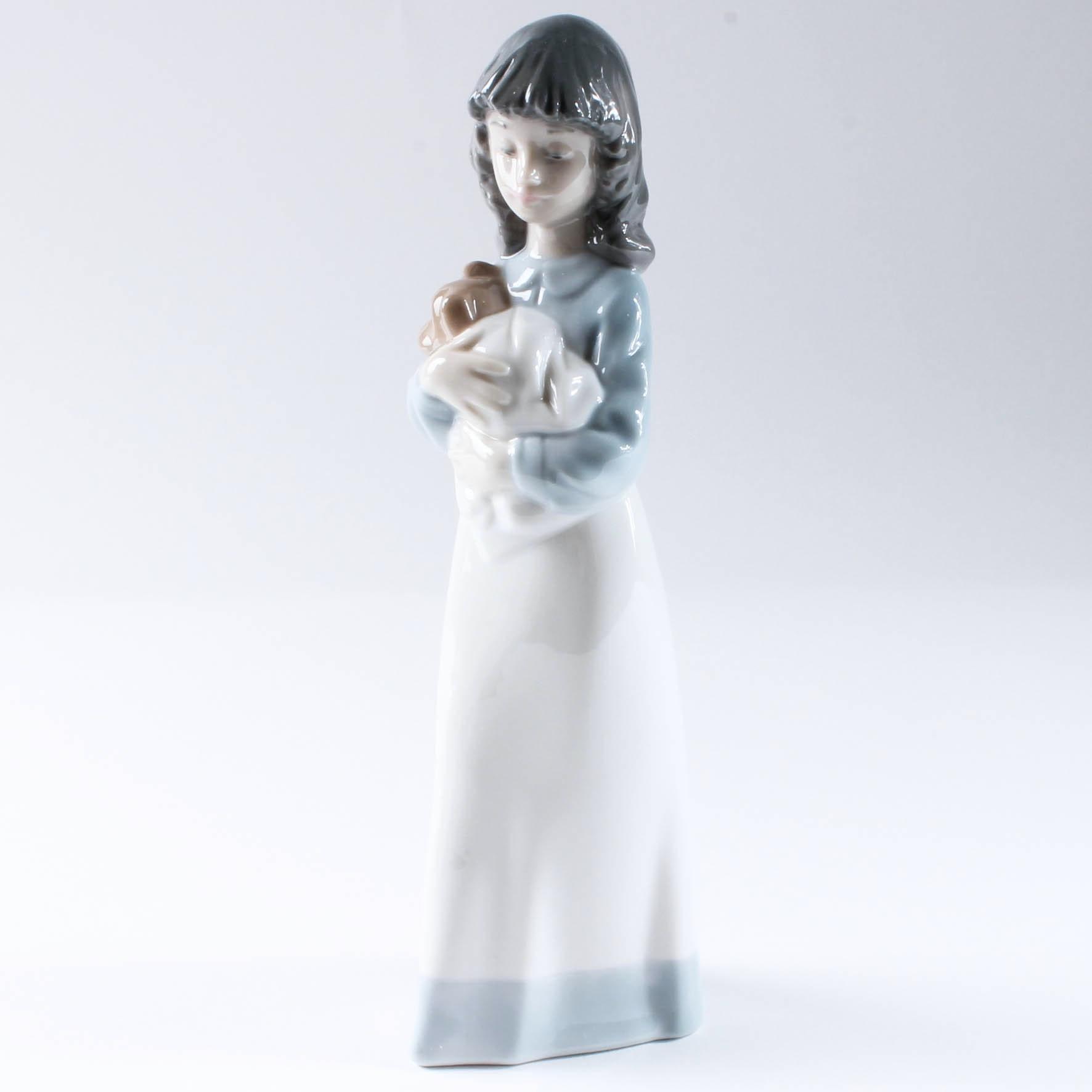Woman Holding Puppy Lladro Figurine