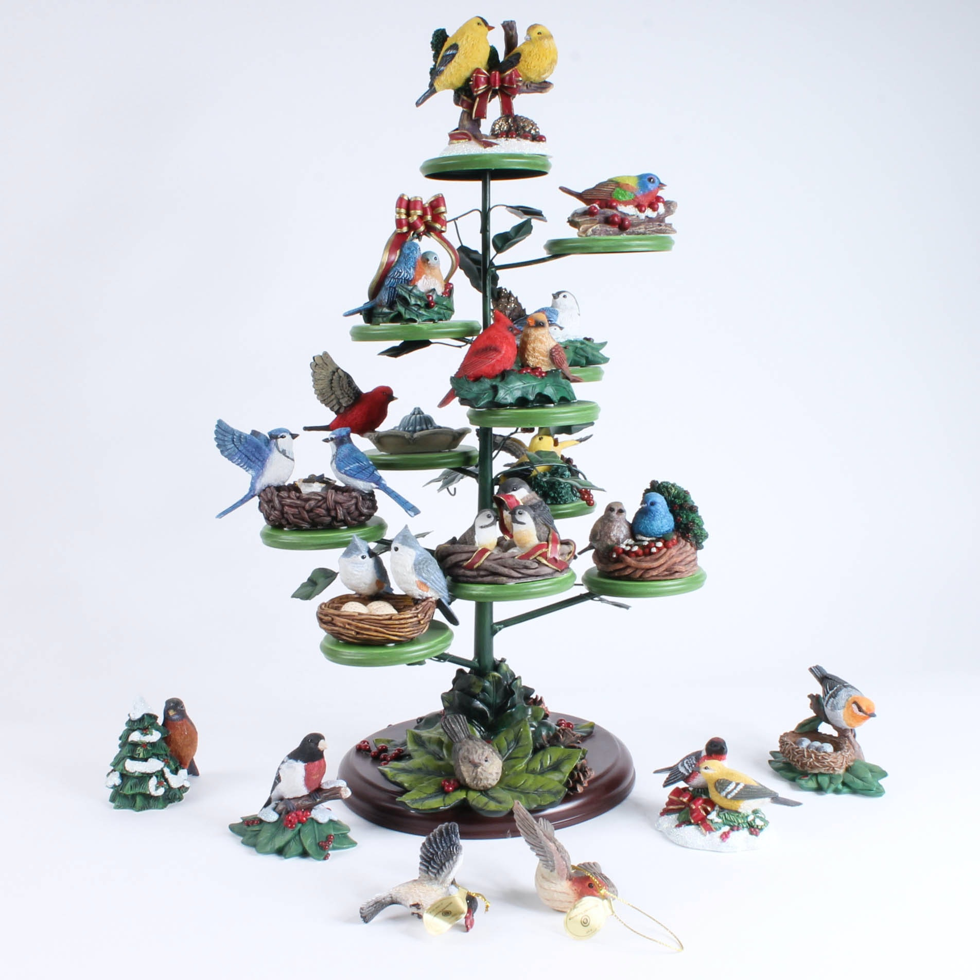 Holiday Figurines and Christmas Tree-Shaped Stand