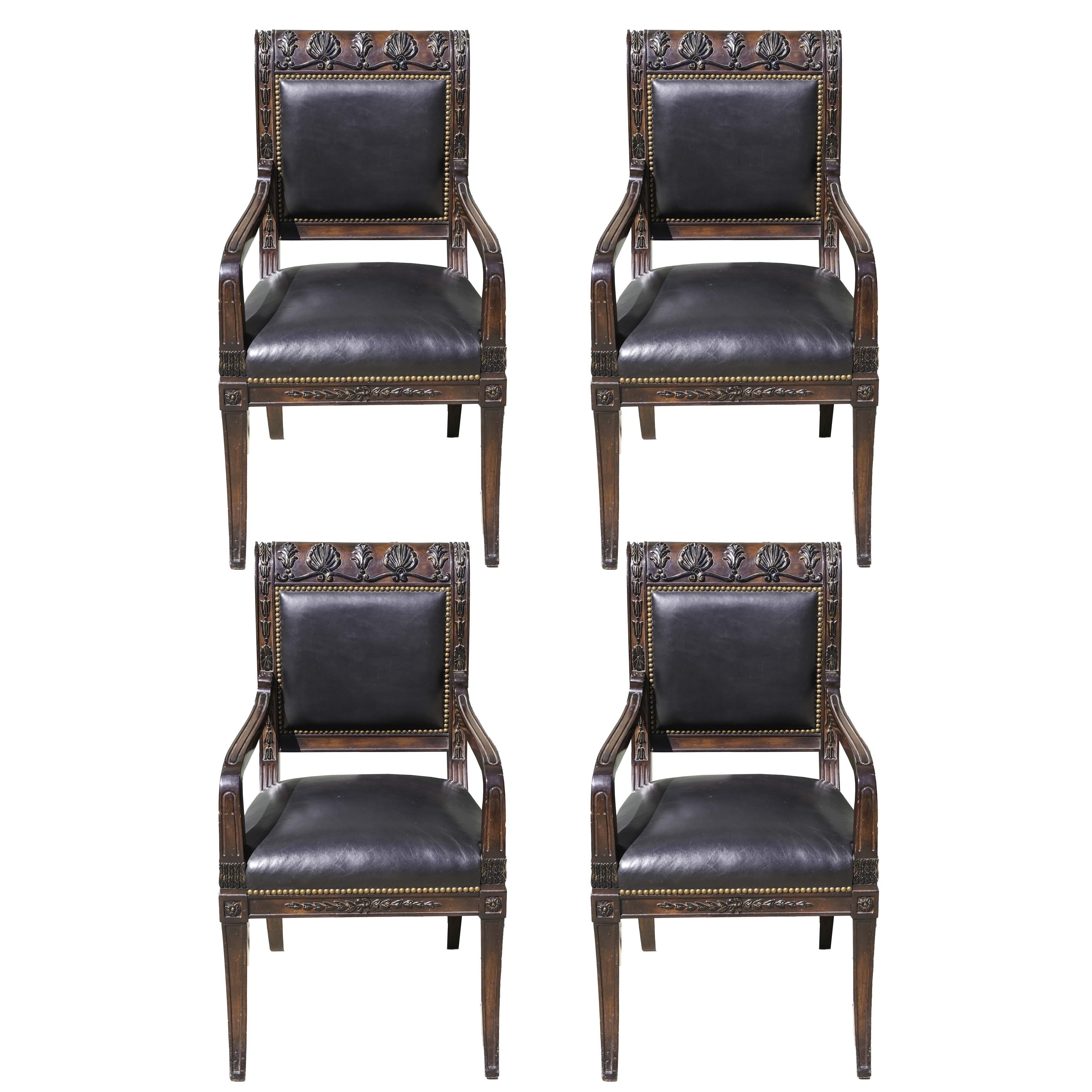 Four Directoire Style Parcel-Ebonized Mahogany Stained Fauteuils