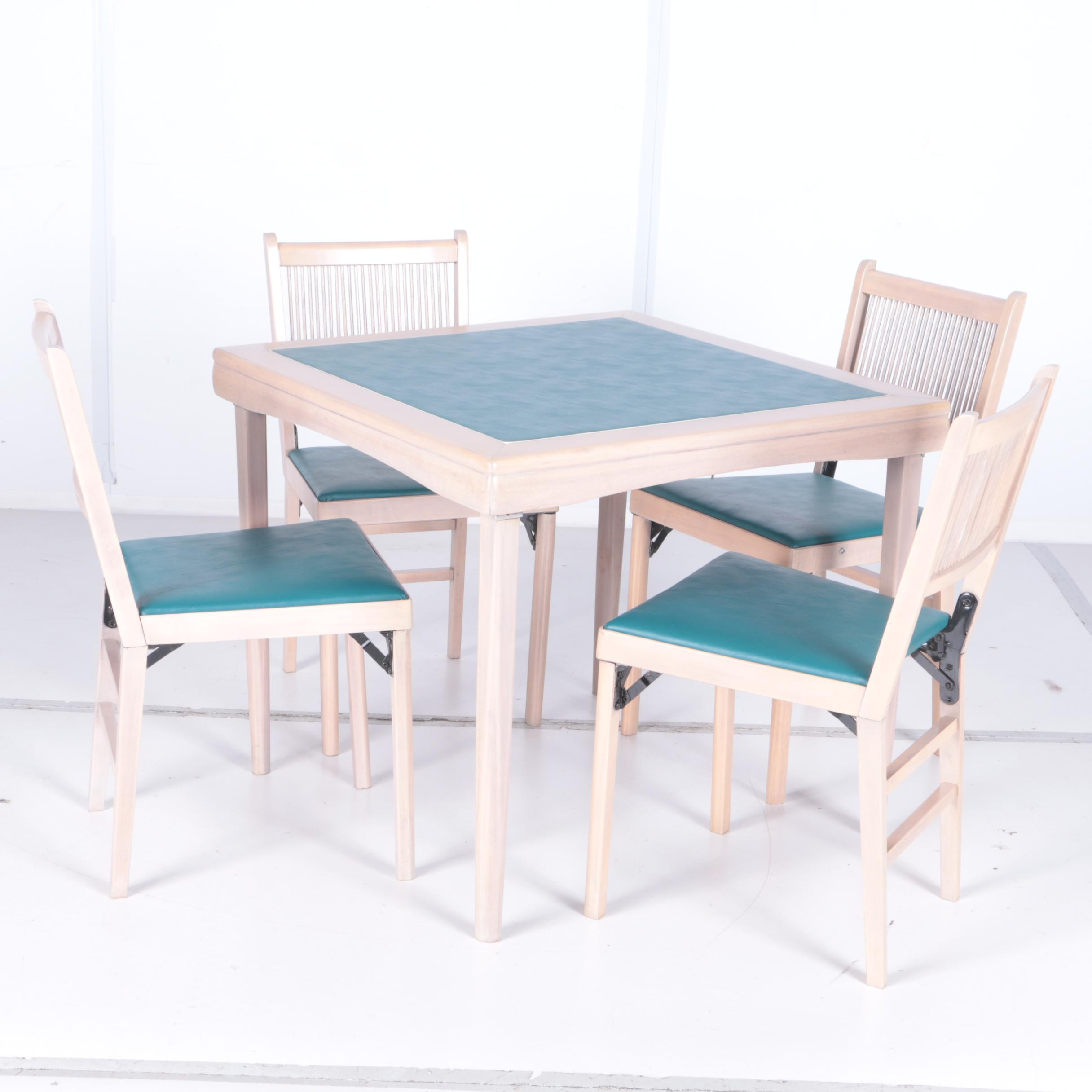 Four Folding Chairs With Table by Leg-O-Matic
