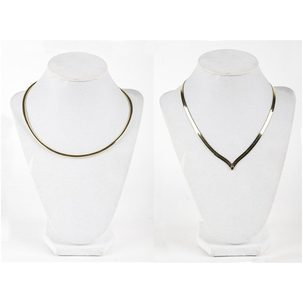 A Pair of 14K Yellow Gold Herringbone and Omega Necklace