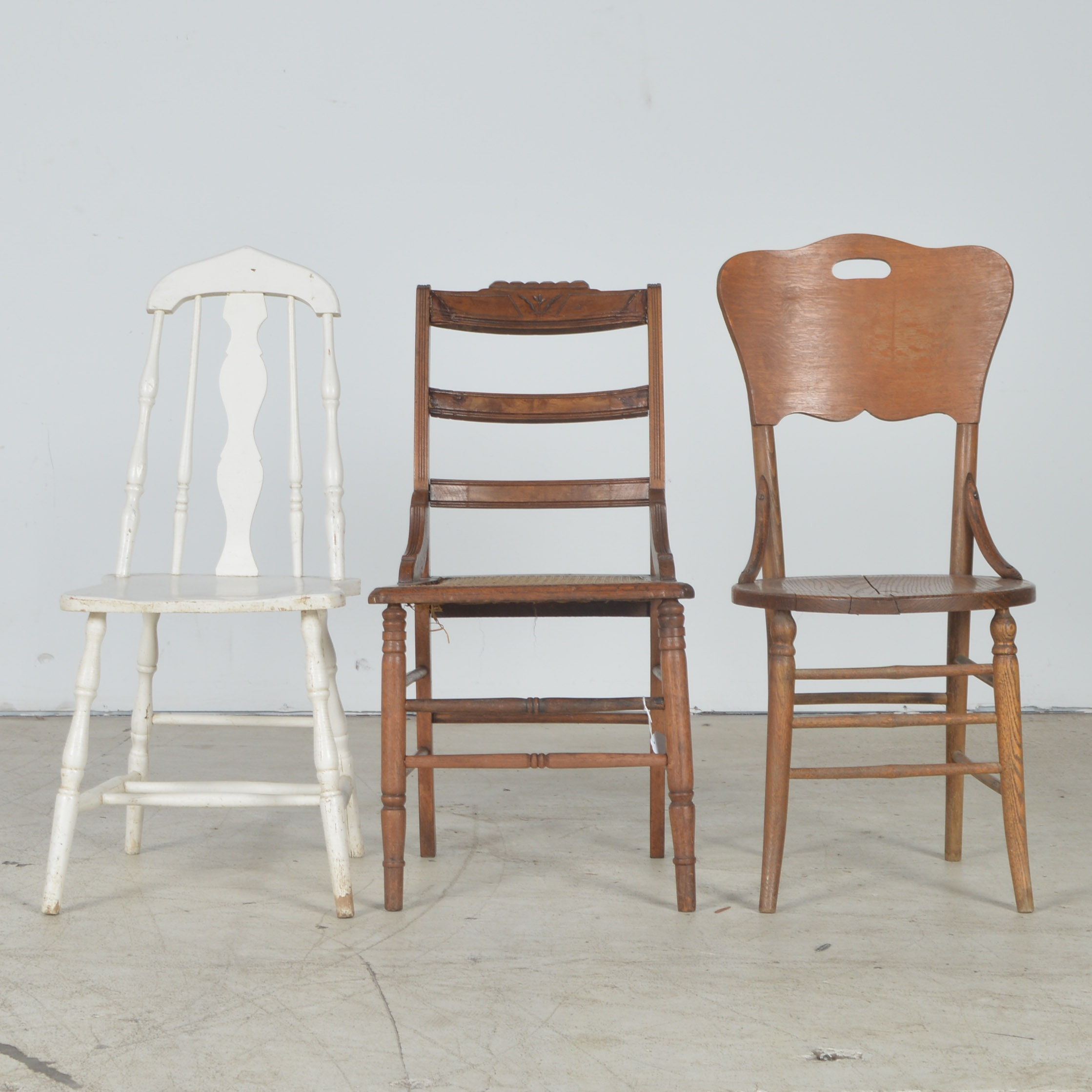 Three Vintage Wooden Chairs