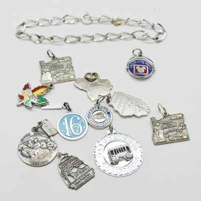 Eleven Sterling Silver Travel Charms and Charm Bracelet