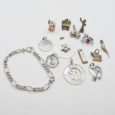Thirteen Sterling Silver Charms and Charm Bracelet