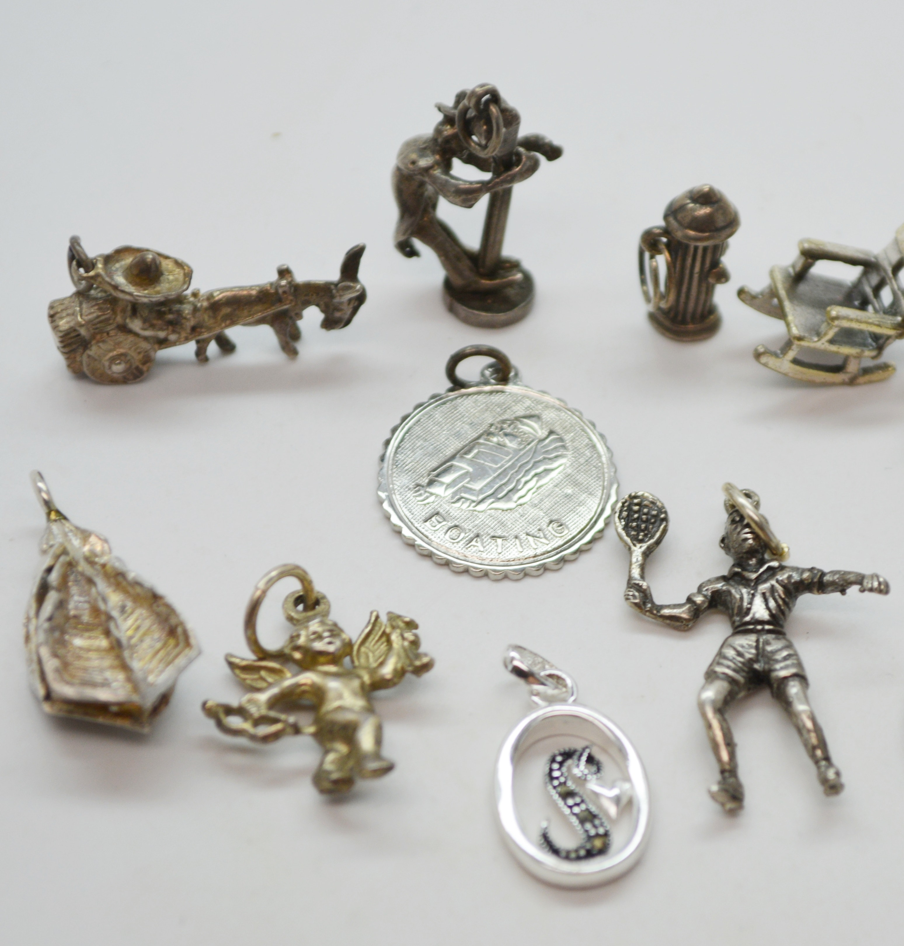 Twelve Sterling Silver Charms