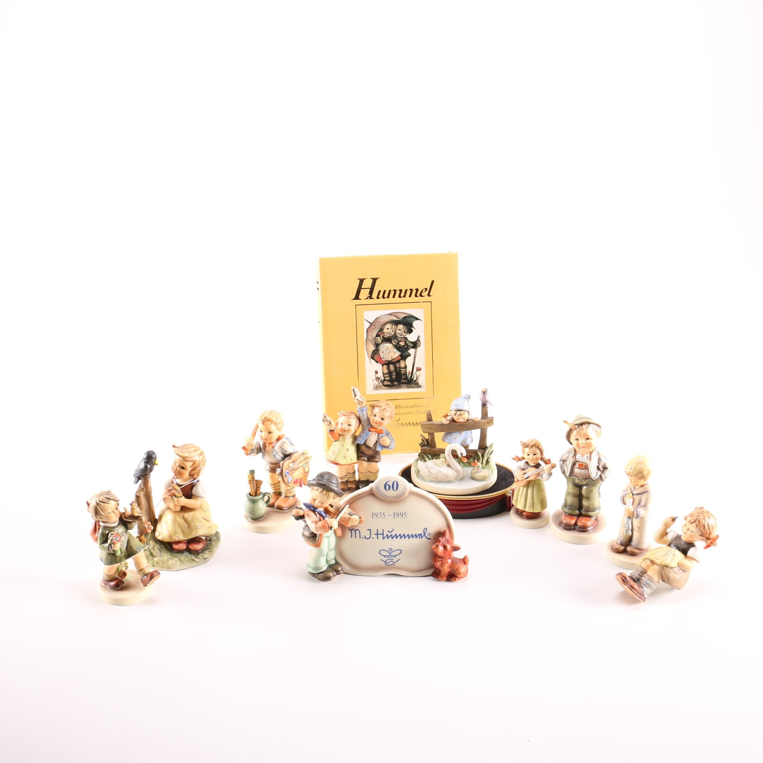 Collection of Hummel Figurines and Book