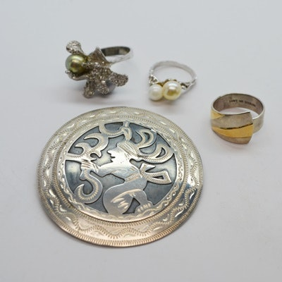 Three Sterling Silver Rings and One 900 Silver Brooch