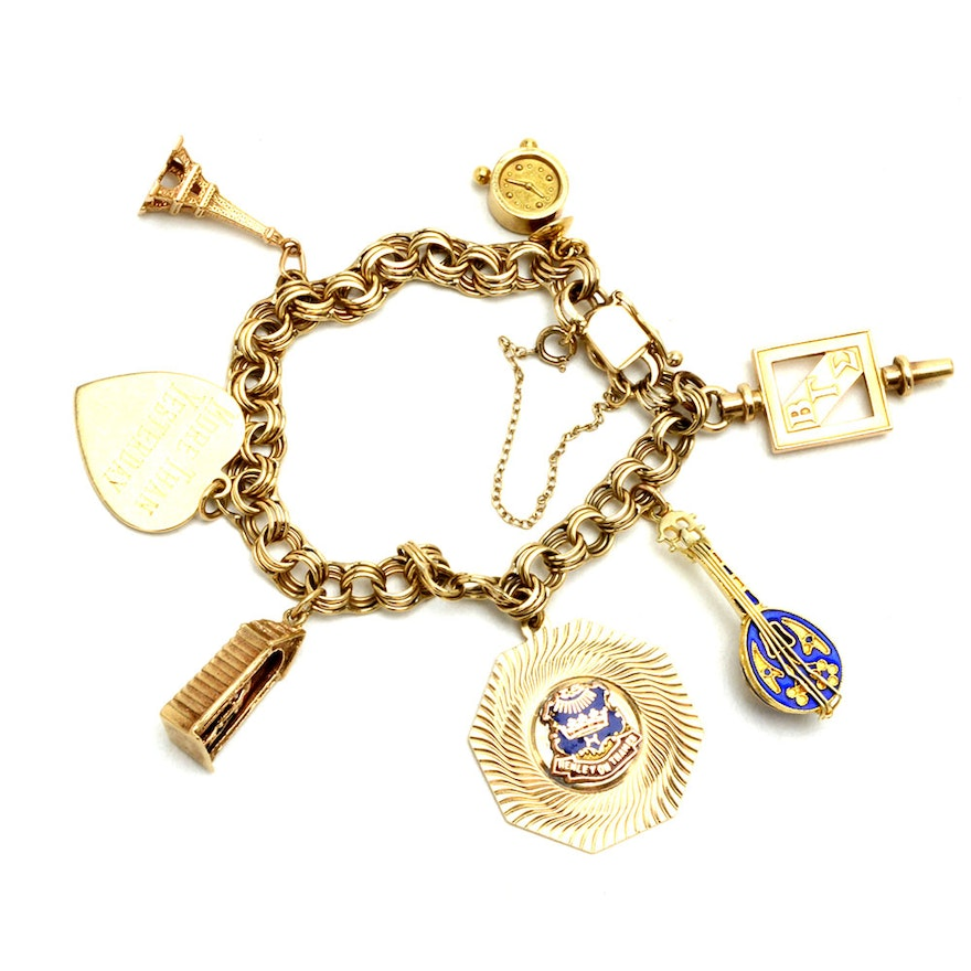 053d357fc6c37 Vintage 14K Yellow Gold Charm Bracelet with 9K to 18K Gold Charms