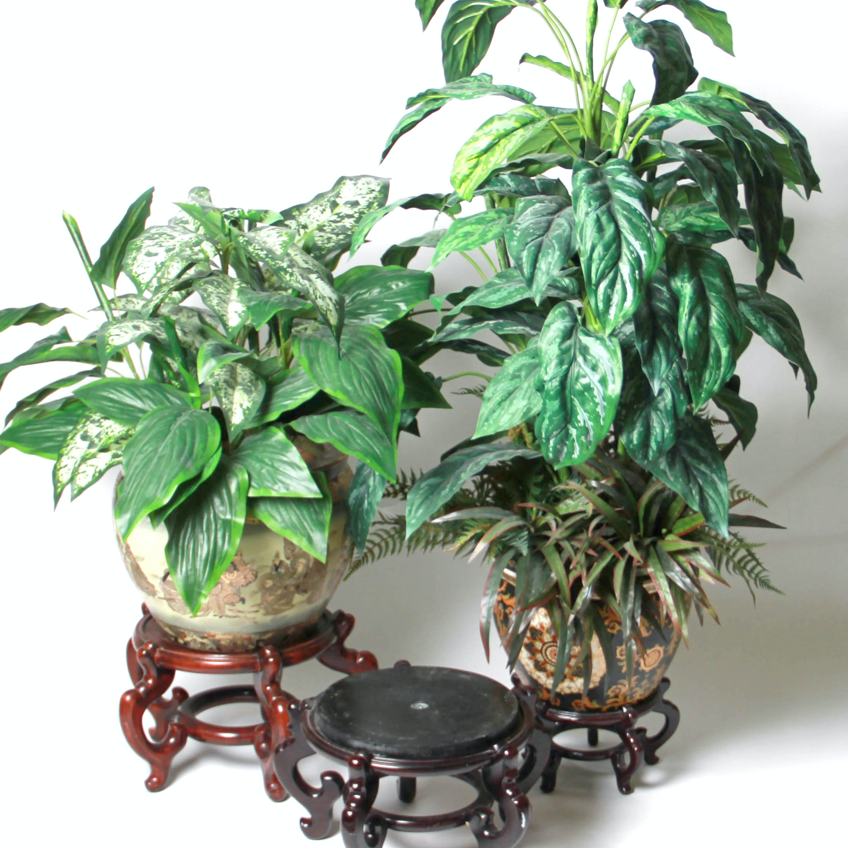 Faux Plants With Decorative Pots and Wooden Stands
