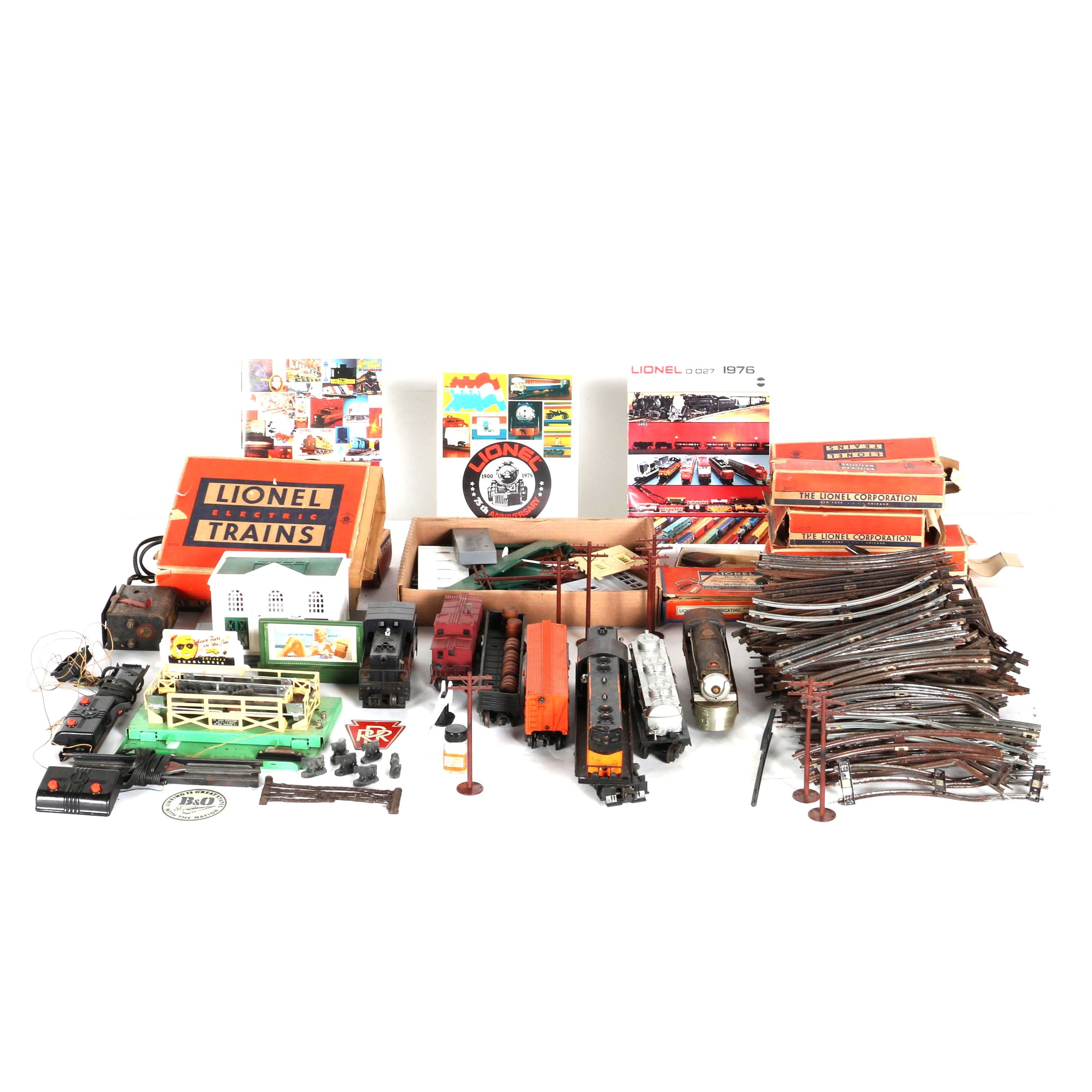 Collection of Lionel Train Cars, Tracks, and Kits