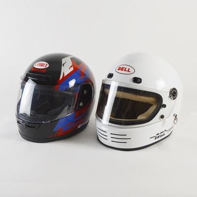 Two Car Racing Helmets