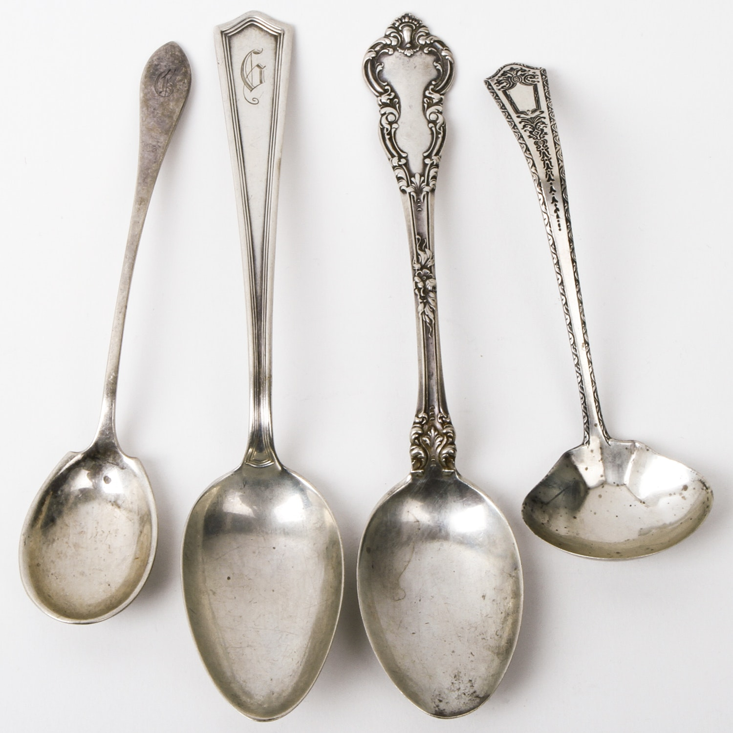 Four Antique Sterling Silver Spoons