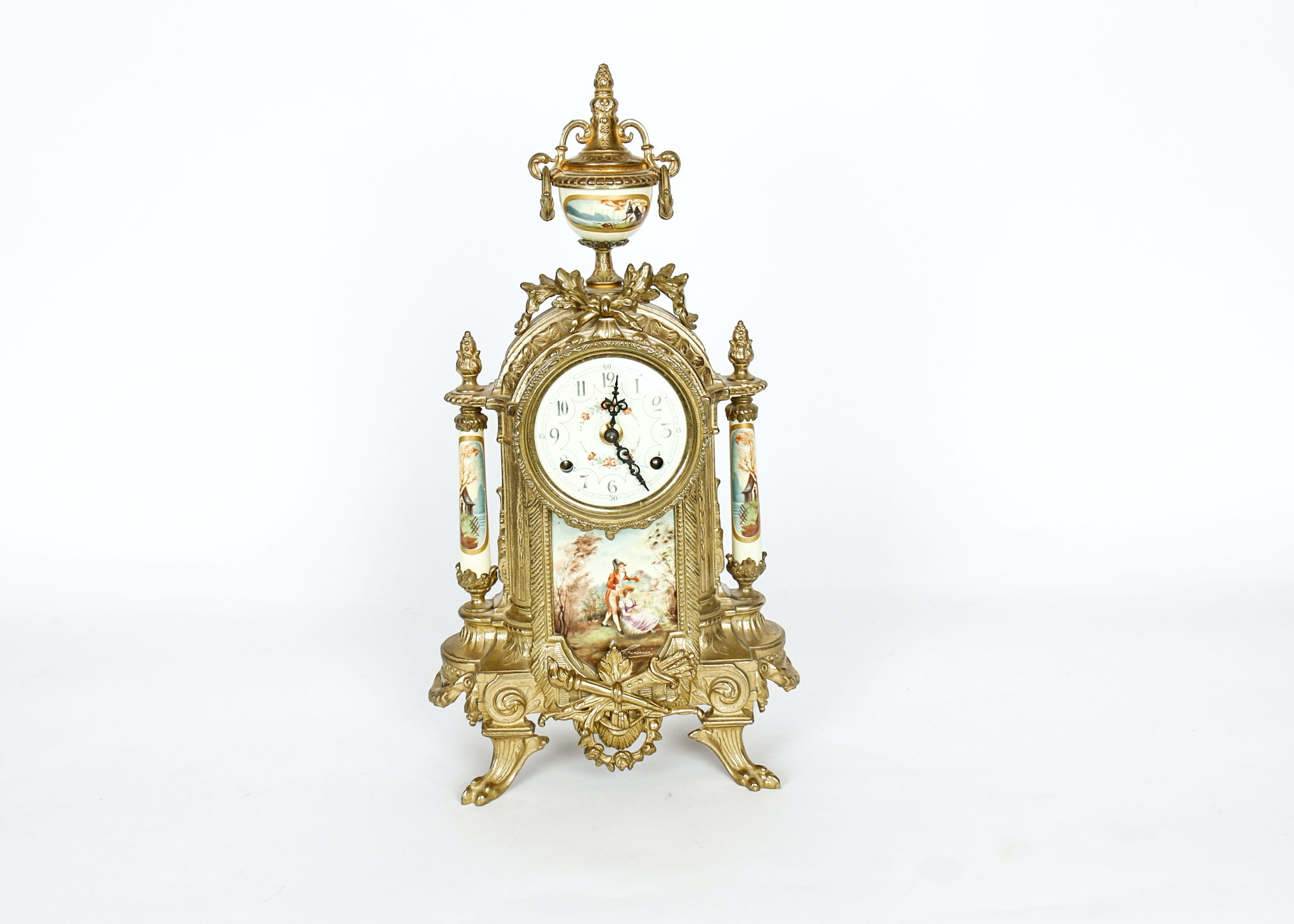 Metal Gold Tone Clock with Floral and Colonial Era Accents